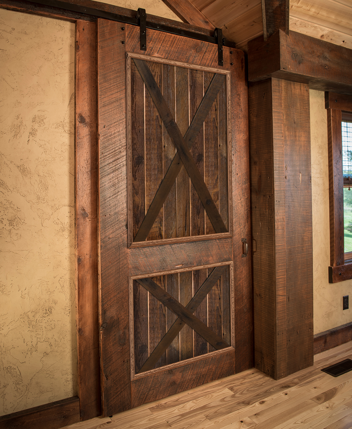 Barnwood doors make a statement in your home with these for Decor barn doors